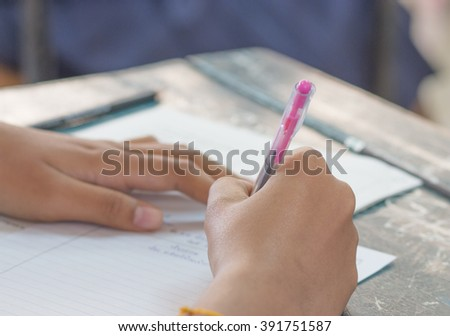 Thai student writing a test in exercise, Exams, selective focus