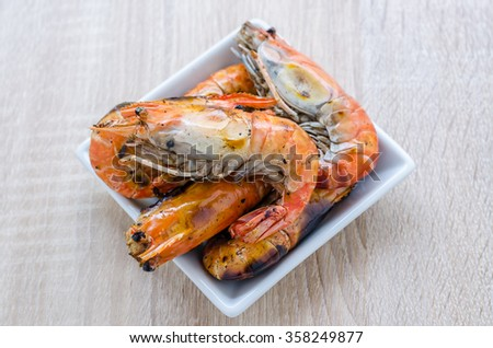 Thai style barbecue, grilled shrimp on wooden background