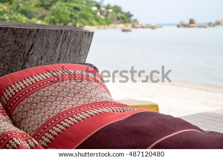 Thai style beach sofa with sea side as background