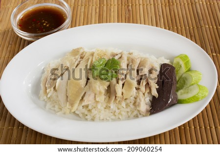 Thai style Chicken rice with spicy dipping sauce (Khao Man Kai) - stock photo