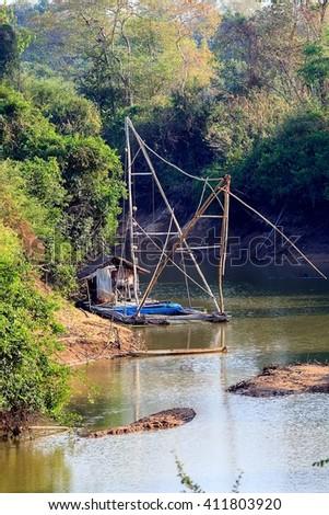 Thai style fishing boat in lake, Net Fishing Thailand, Thailand Shrimp Fishing, at Mekong river Thailand. - stock photo