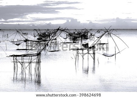 Thai style fishing trap in Pak Pra Village, Net Fishing Thailand, Thailand Shrimp Fishing, Phatthalung, Thailand.Image contain certain grain or noise and soft focus - stock photo