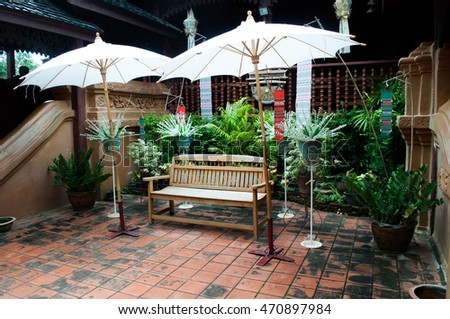 Thai style garden with a chair , sunshade . Holiday