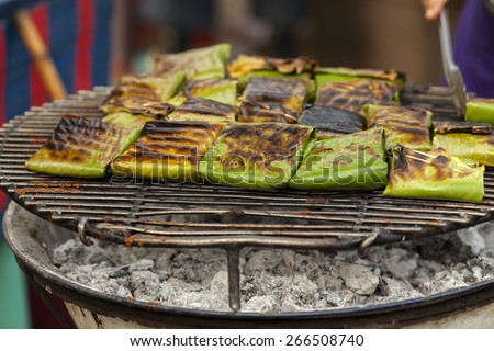 Thai style grill in banana leaf - stock photo