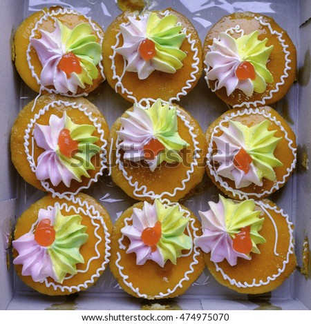 thai style orange cup cake with hand made colorful decoration in paper box