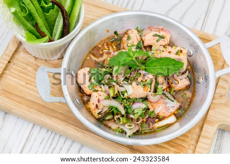 Thai Style Spicy Salmon salad with fresh vegetable - stock photo