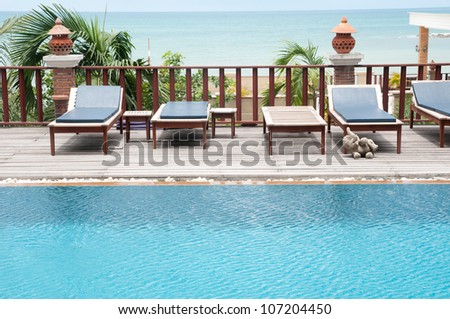 Thai style  swimming pool with villa against sea