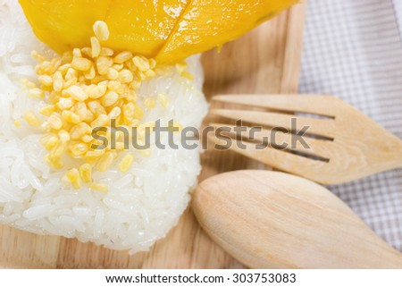 Thai style tropical dessert,sticky rice with mango/focus on one point and  shallow depth of field instragram fillter