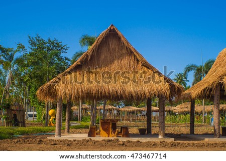 Thai style with thatched cottage.