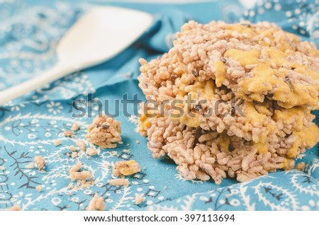 Thai Sweet Crispy Rice with Cane Sugar to sprinkle on top.  - stock photo