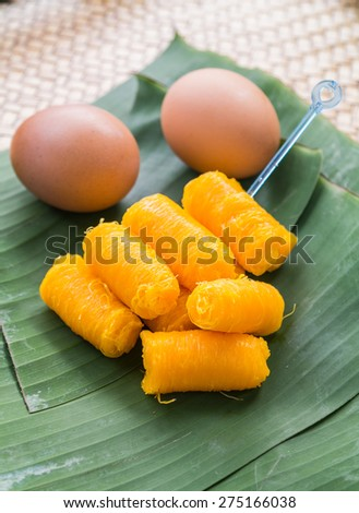 Thai sweet, Thai dessert, powder and egg cooked in syrup on banana leaf background