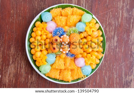 Thai sweets, or ??Khanom Thai?�, have unique, colorful appearance and distinct flavors. The art of Thai desserts have been passed down through the generations. - stock photo
