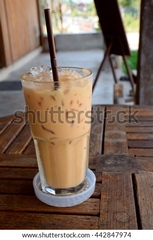 Thai tea  of glass on the wooden table in cafe, Thailand
