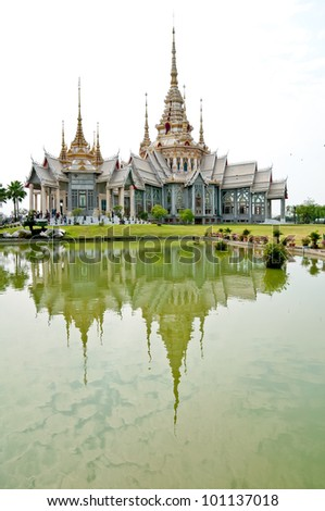 Thai temple and reflection on water