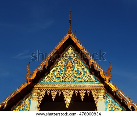 Thai temple soaring into blue sky