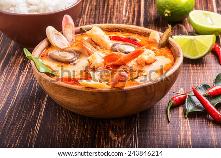 Thai Tom Yam soup with shrimp and shiitake mushrooms, served with lime and rice - stock photo