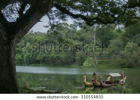 Thai traditional boats on the lake near,Bayon temple in Angkor Thom, Siemreap, Cambodia.