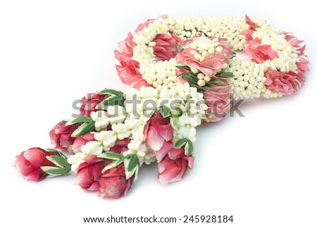 Thai traditional craft flower garland isolated on white background.