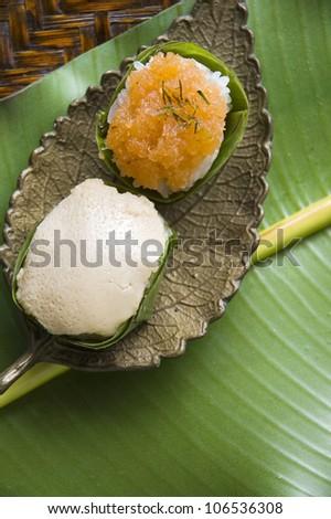 ... rice custard wrapped in banana leaf at thai street market, thailand