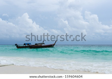 Thai traditional long tail boats on the beach, li-pe island