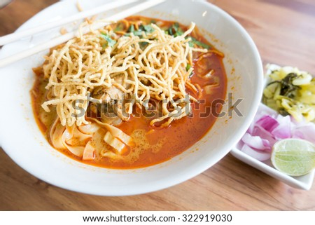 Thai traditional noodle in spicy curry soup (Kao Soy) - stock photo