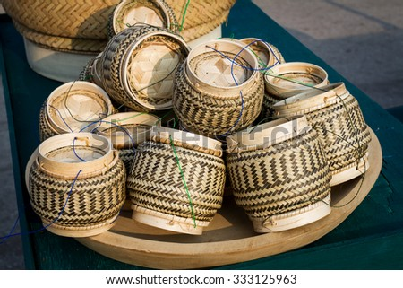 Thai traditional rice box It is called Kratib wicker container made of bamboo, for packing sticky rice. More common in Thailand and Laos material used for put glutinous rice of people in countryside