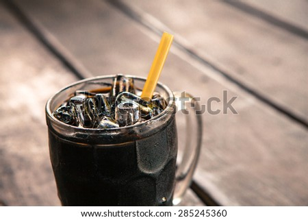 Thai vintage style Iced Black Coffee on wooden background - stock photo