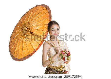 Thai woman dressing traditional costume holding an umbrella - stock photo