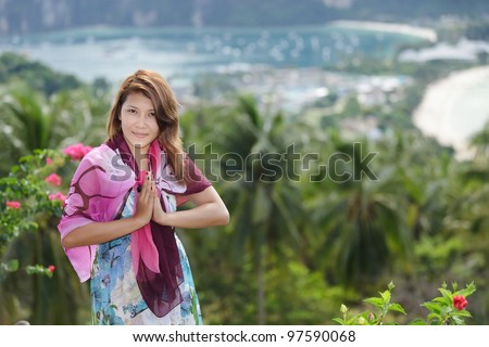 thai woman greetings sign in ko phi phi island, thailand - stock photo