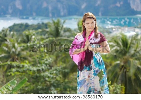thai woman greetings sign in ko phi phi island viewpoint, thailand - stock photo
