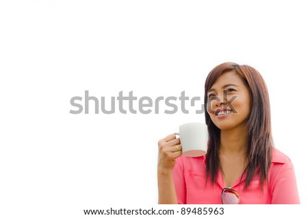 Thai woman holding coffee cup in her hand and looking something