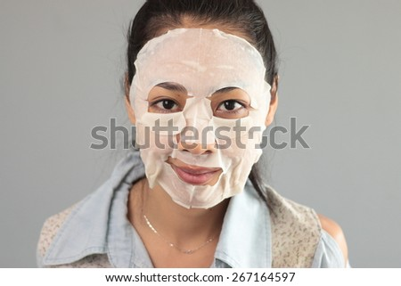 Thai woman put on facial mask.