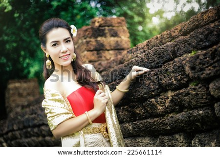 Thai woman wearing typical Thai dress, identity culture of Thailand - stock photo