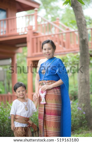 Thai women and Boy traditional Thai suit.