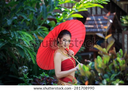 Thai women in Traditional Costume  with red umbrella - stock photo