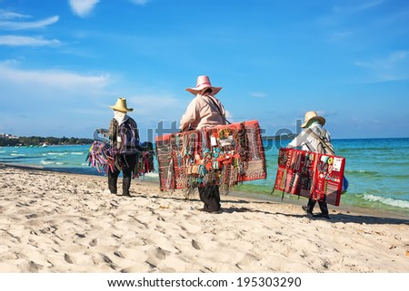 Thai women selling beachwear at beach in Koh Samui, Thailand. - stock photo