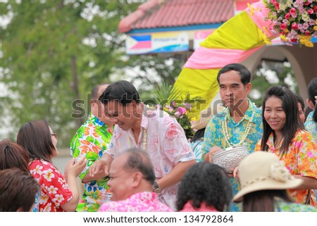 THAILAND - APRIL 11: Thai people celebrate Songkran (new year / water festival: 13 April) by giving garlands to their seniors and asked for blessings on April 11, 2013 in Nakhonratchasima, Thailand. - stock photo