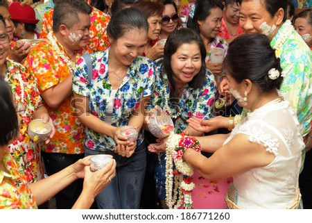 THAILAND - APRIL 11: Thai people celebrate Songkran the new year water festival  by giving garlands to their seniors and asked for blessings on April 11, 2014 in Nakhonratchasima, Thailand.  - stock photo