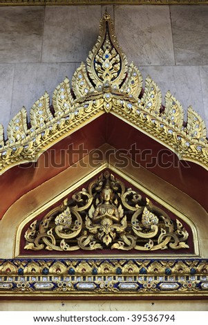 Thailand, Bangkok, Dusit District, Benjamabopit Temple (Wat Benjamabopit), golden ornaments above one of the entrance doors