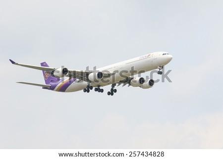 THAILAND,BANGKOK-MAR 3:Thai airways plane flying above suvarnabhumi airport runway and prepare to landing  in bangkok on march 3,2015 in  Bangkok Thailand - stock photo