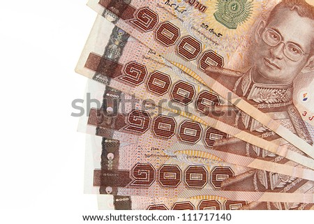 Thailand banknotes arranged on a white background.