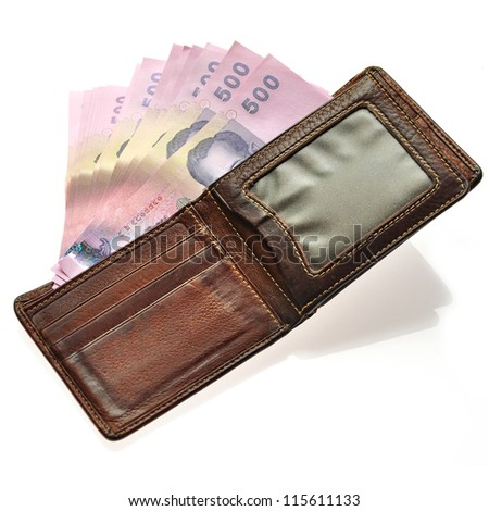 Thailand banknotes from wallet on white background