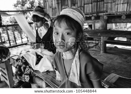 Thailand, Chang Mai, Karen Long Neck hill tribe village (Kayan Lahwi), young girl and her mother in traditional costumes - stock photo
