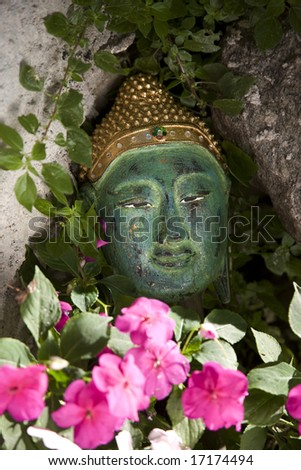 Thailand. Chiang Mai. Buddha's face carved in wood in  Buddhist temple. - stock photo