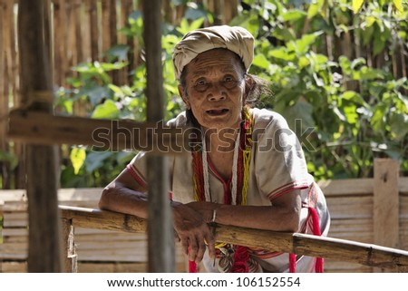 Thailand, Chiang Mai, Karen Long Neck hill tribe village (Kayan Lahwi), a Karen woman in traditional costumes - stock photo