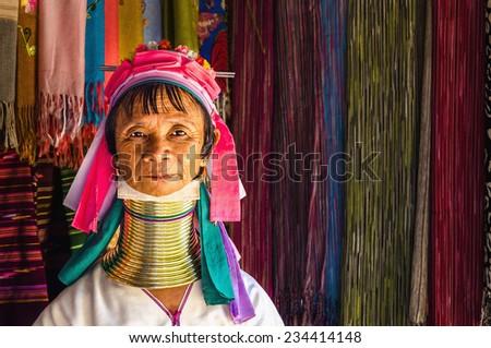THAILAND, CHIANG MAI - NOVEMBER 2, 2014: Women of the Kayan Lahwi tribe known for wearing neck rings, brass coils to extend the neck. Kayan, Red Karen (Karenni), Long-Neck trib, Giraffe women.  - stock photo