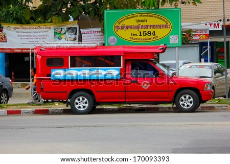 THAILAND / CHIANGMAI - SEPTEMBER 18 2012: Red taxi chiangmai, Service in city , thailand.