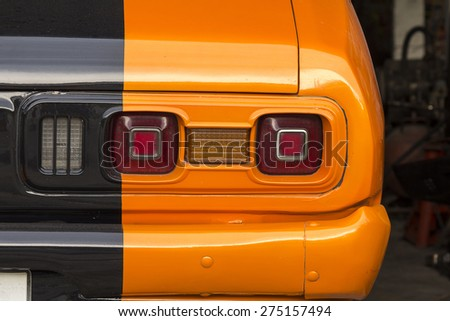 THAILAND,CHONBURI -MAY 4: Rear light of a custom car in the garage waiting for fix on 4 MAY 2015.This is custom car model. - stock photo