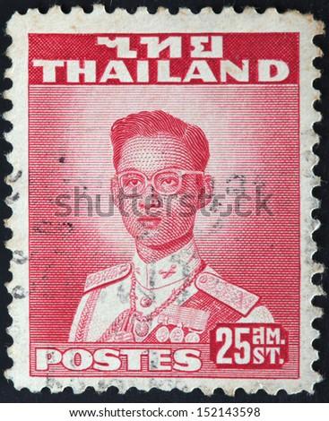 THAILAND - CIRCA 1960: A stamp printed in Thailand shows King Bhumibol Adulyadej, circa 1960  - stock photo