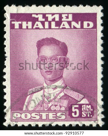THAILAND - CIRCA 1951-1960: A stamp printed in Thailand shows portrait of Bhumibol Adulyadej Rama IX of Thailand (glasses), circa 1951-1960